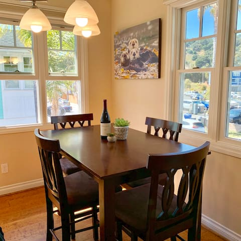 Comfortable dining area with beautiful views of local hills and photos of Avila's very own sea otters! Enjoy a bottle of local wine from one of our many wineries.