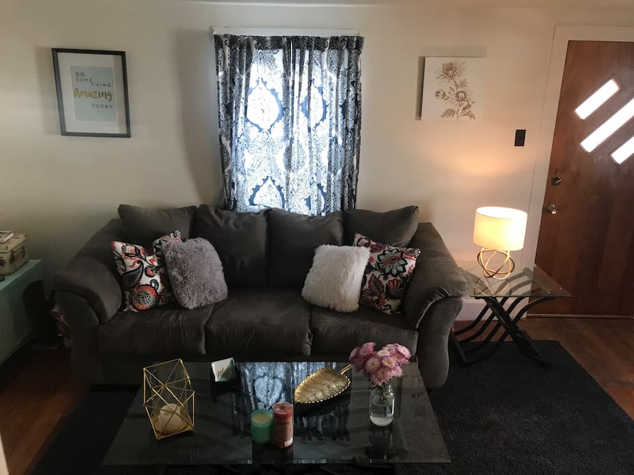 Cozy living room with couch and loveseat