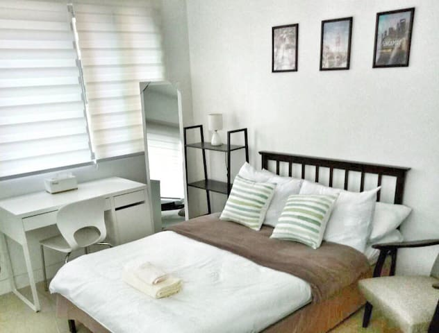 Deluxe studio room with comfy double bed and pull-out single bed