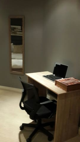 Study desk for business travellers . Free uncapped wifi. Bedroom mirror.
