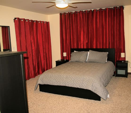 Master bedroom with Queen bed and only access to 2nd floor deck