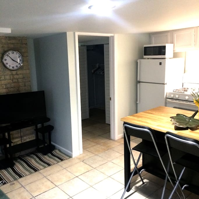 Full kitchen with stove, coffee maker, coffee, microwave, refrigerator, and toaster