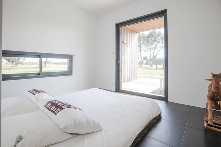 gorgeous view, especially in the morning of the unobstructed 10 acres of land, electric blinds if you prefer it dark