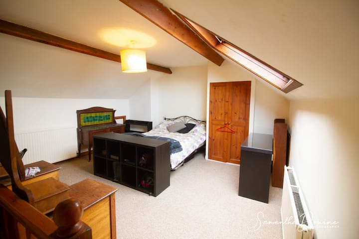 Large attic double room with desk and workspace