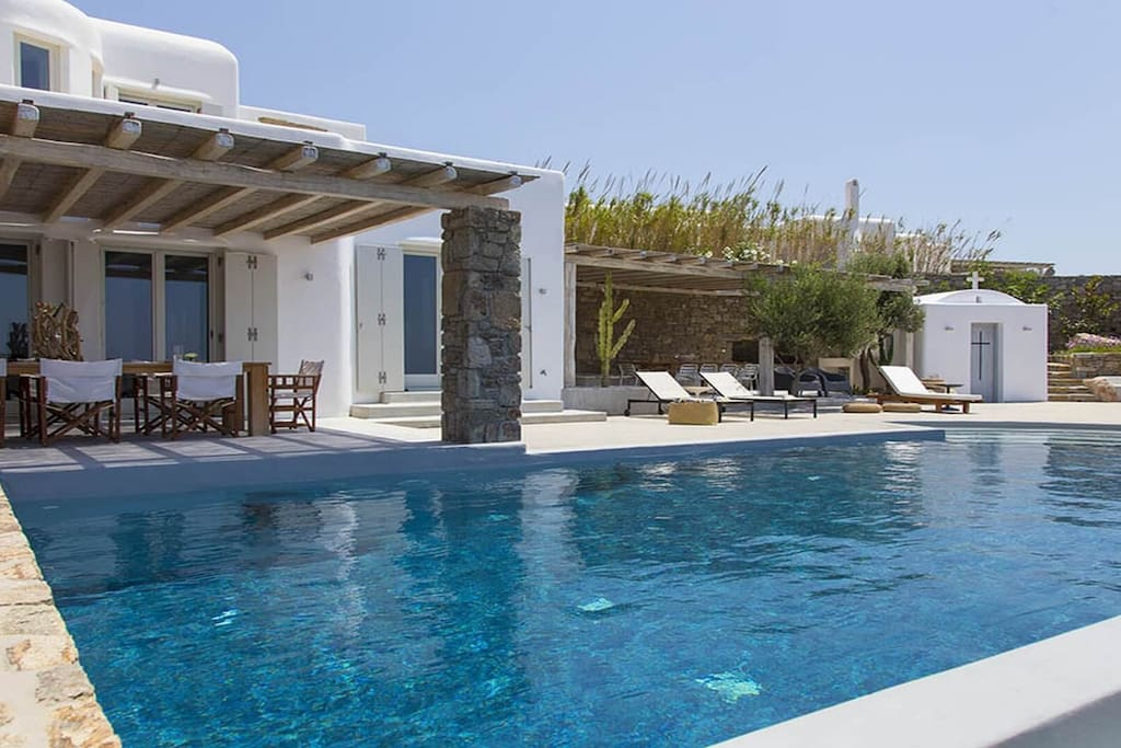Swimming pool, lounge area & private chapel