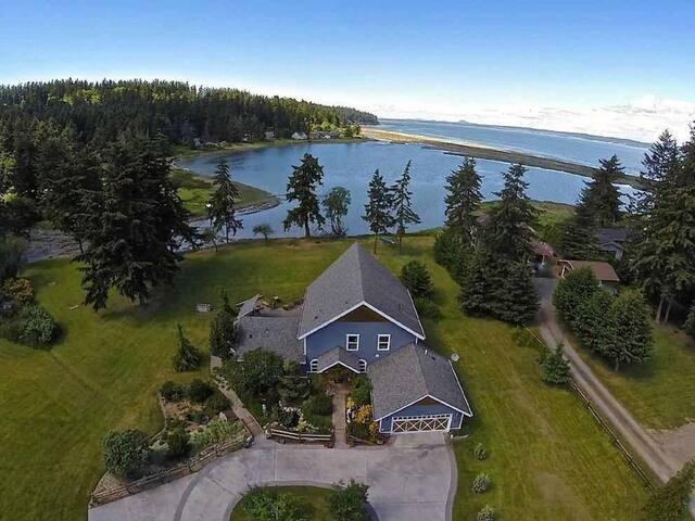 Luxury Lodge Custom Home on Oceanfront Lagoon.