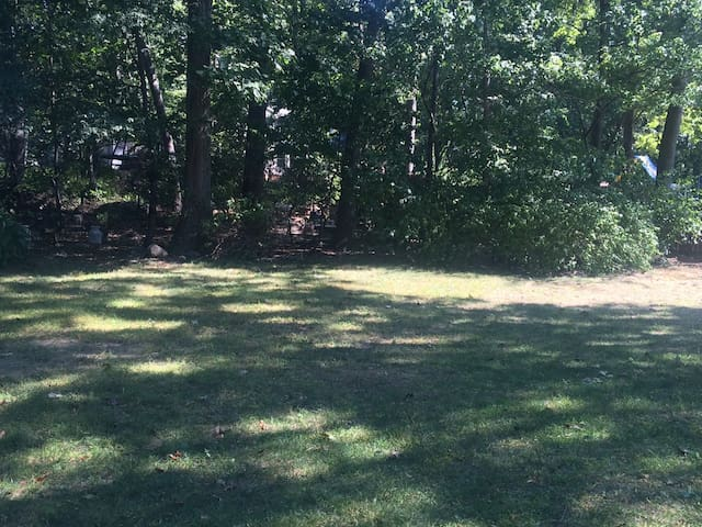 Flat , open and wooded back yard perfect for soccer , wiffell ball,volleyball or any entertaining