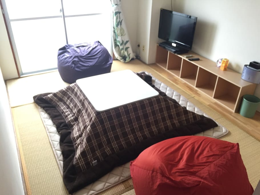 A kotatsu is a traditional heating system in Japan, which is a table and a heater combined as one piece of furniture.