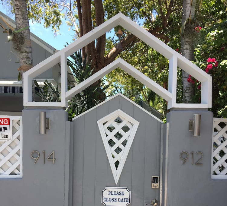 Gated compound with electronic lock.  Gate to the Family House at 912-914 Center Street.