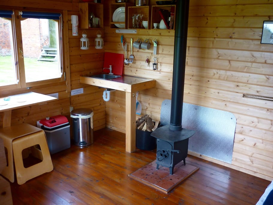 Kitchen and dining area with wood burning stove for cooking and keeping you cosy........
