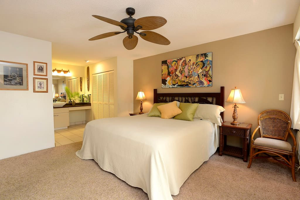 Huge bedroom has new comfy king bed with pillow top, traditional Hawaiian art and attached bathroom.