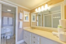 The master bathroom is fully stocked with fresh linens.