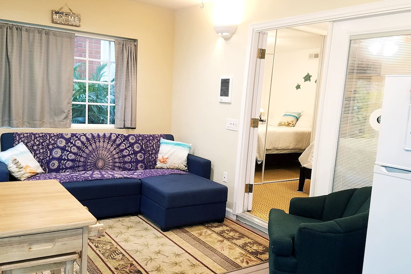 Quaint living room/kitchenette area opens to bedroom thru glassed French doors.