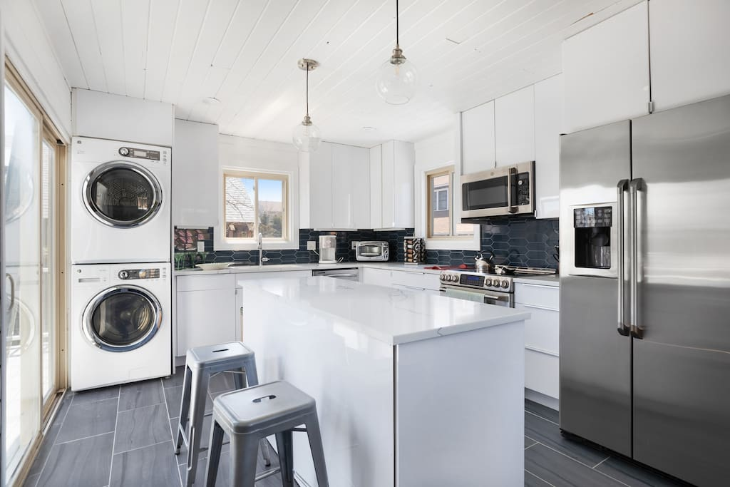 This modern kitchen is newly renovated with stainless steel appliances.