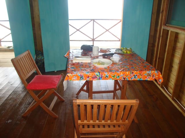 The dining area, comfortable for 2 to 4, provides views to the west and south.