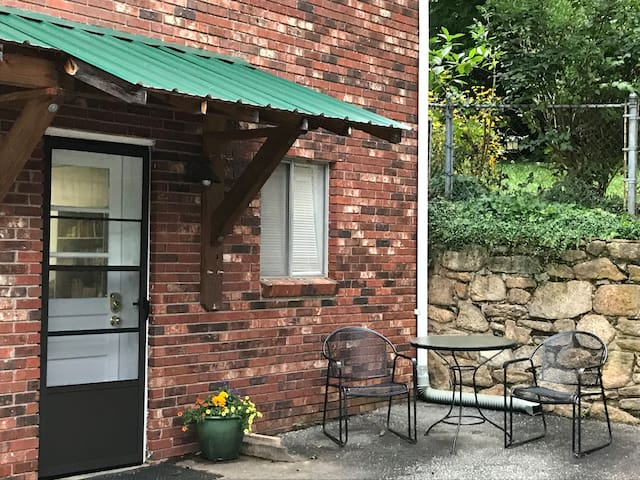 Separate entrance with key code and outdoor seating.