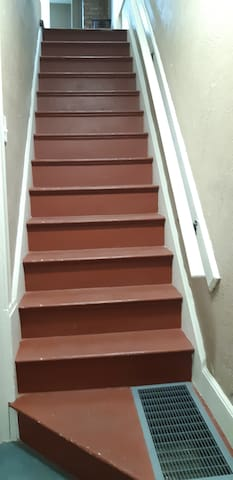Stairs leading upstairs to the apt.