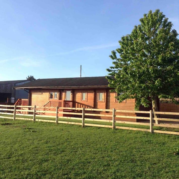 Peaceful farm stay in a Shropshire log cabin.