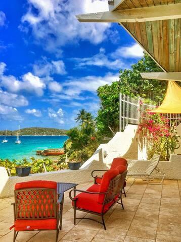 Outdoor patio seating overlooking the water