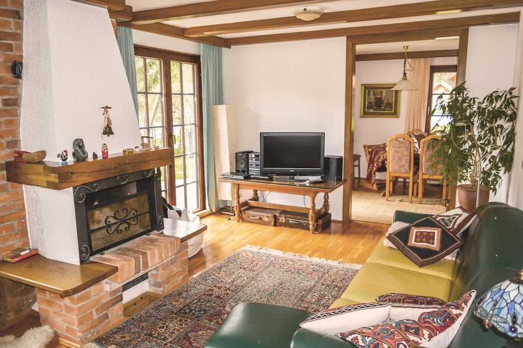 Living room with direct access to the terrace and a chimney