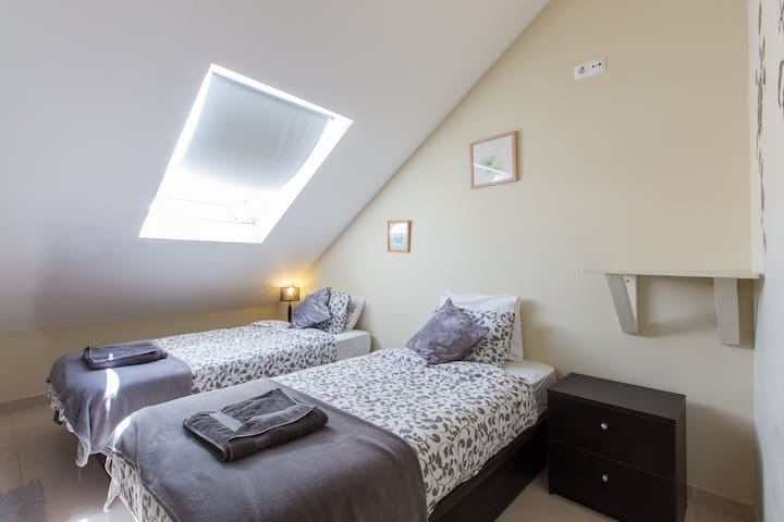 Attic twin or double room sharing 2 bathrooms with 2 other rooms ,sea and city views