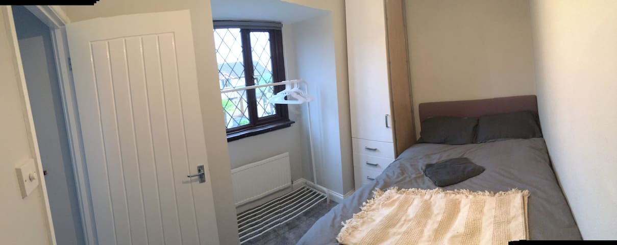Clean tidy bedroom with double bed and wardrobe.