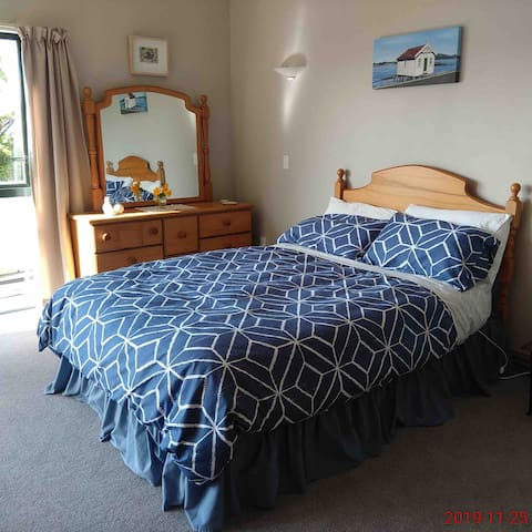 Bedroom #2 Double bed facing north with stunning views. French doors leading to patio.