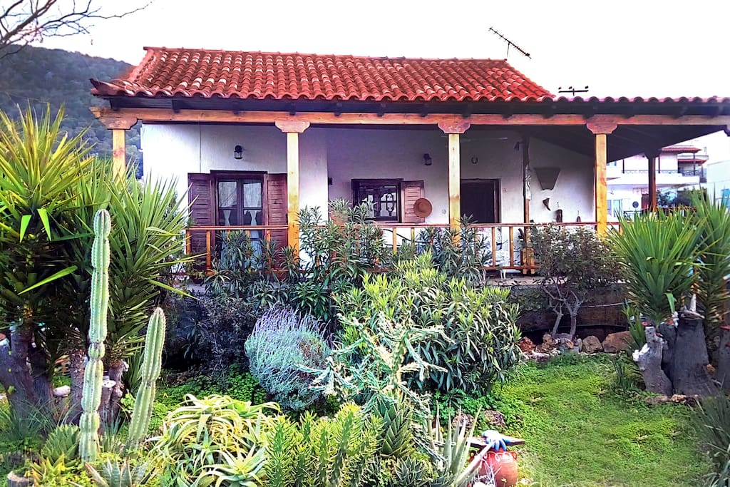 Xanthi's home; The detached maisonette with its garden