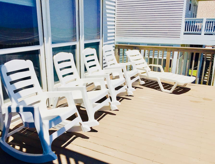 4 sturdy rocking chairs, 2 side tables, & 1 lounge chair on main deck