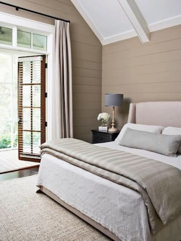 Spacious bedroom with a box spring