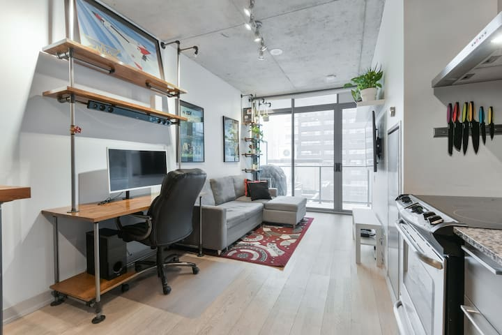"For productivity, there is a desk with a 34"" curved ultrawide monitor, HDMI input, and gigabit wireless internet.   The desk/bookshelf is a matched pair by Hoskins Design of Toronto. Turn the water switch to the left and see what happens!"
