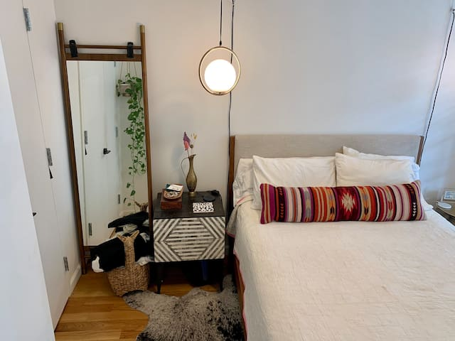 Queen Size bed with Casper pillows. Bedroom faces quiet private yard in back.