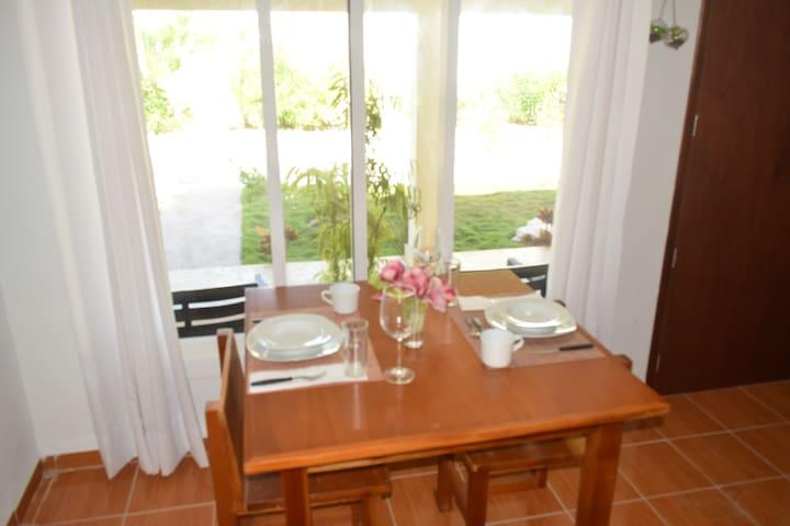 Dine overlooking the courtyard gardens