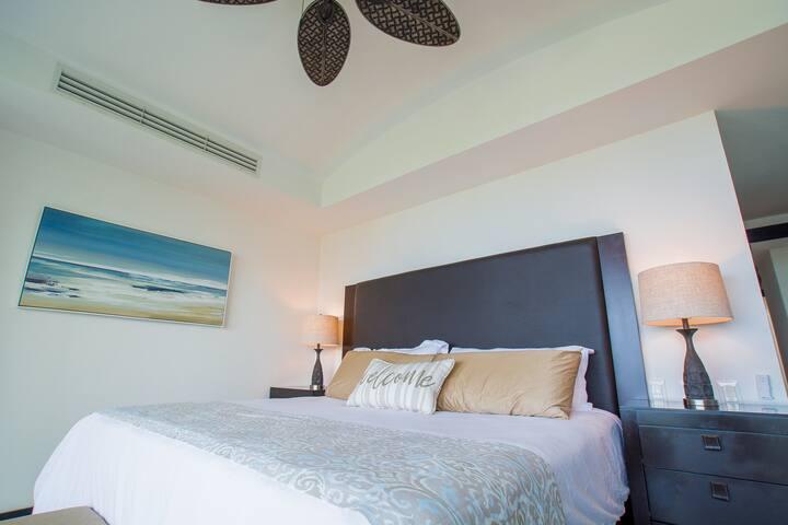 Master Bedroom - Ocean View, Balcony, King Bed, Air Conditioning, Smart TV, Cable, Room Darkening Shades, En Suite Bathroom with Dual Sinks, Walk-in Closet