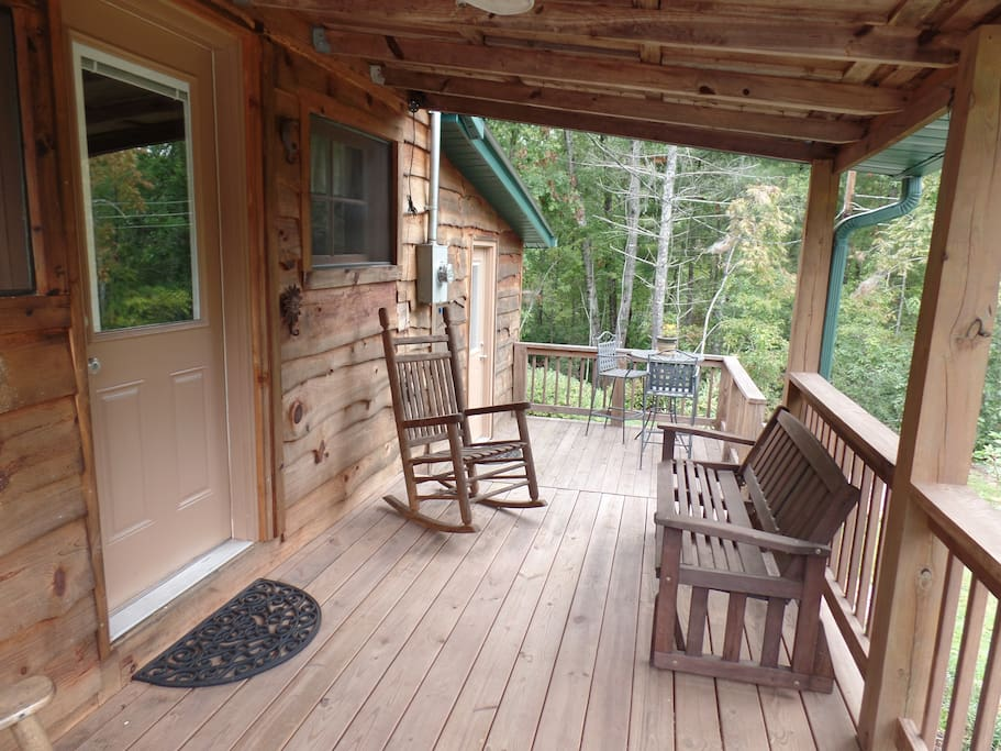 Outdoor sitting porch. Covered or Sunny for morning coffee.