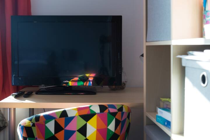 TV with Amazon Stick, Desk and Chair