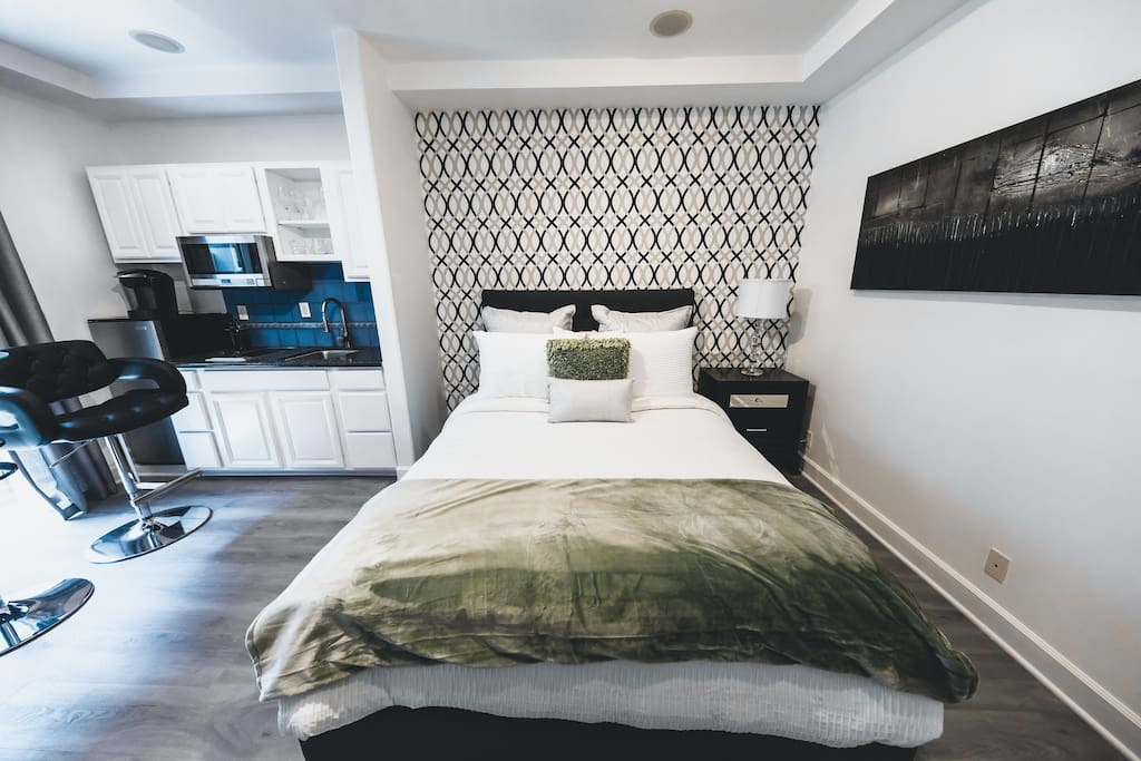 Queen Bed with down bedding and extra pillows