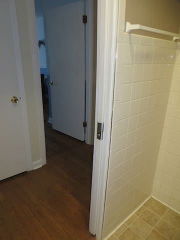 from bathroom's pocket door looking toward guest bedroom door