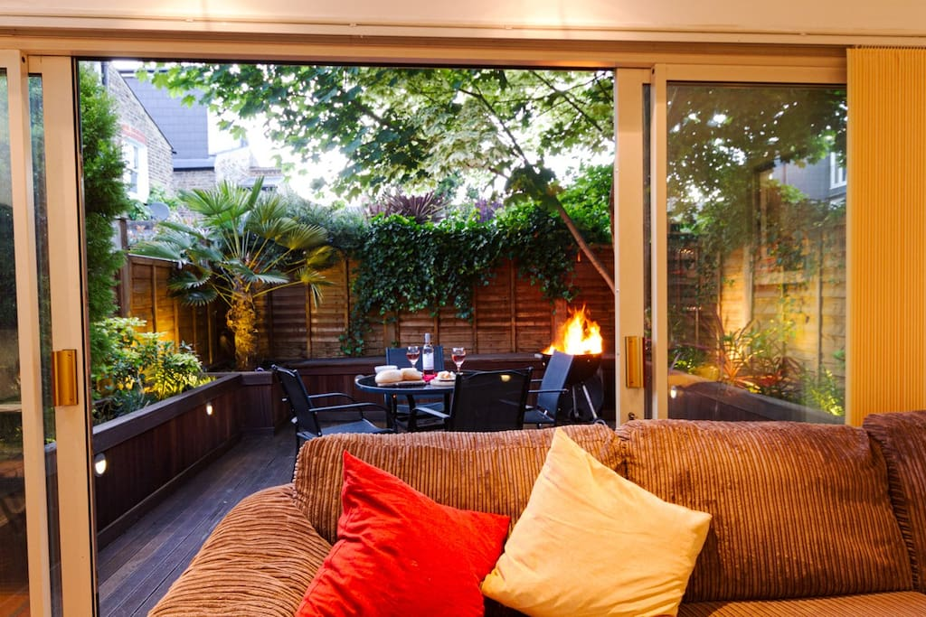 The sitting room opens onto the deck, creating a large and welcoming entertainment area.