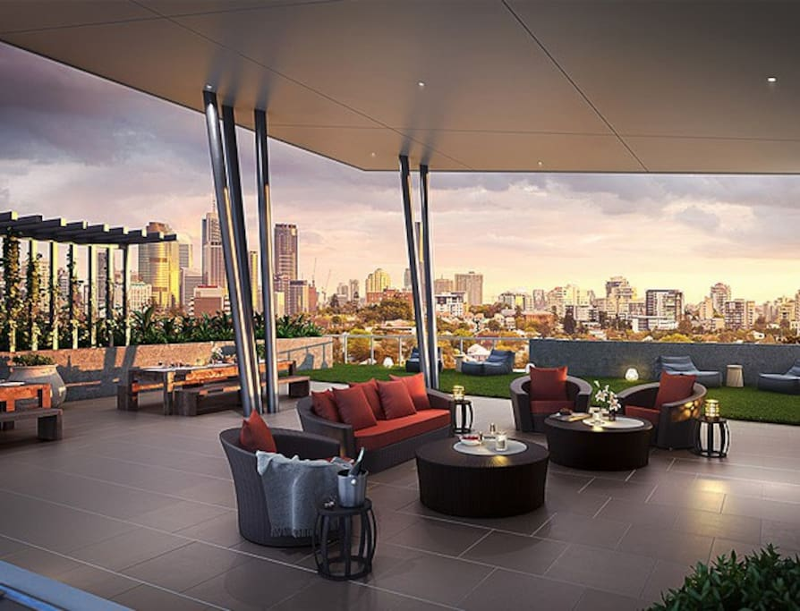 spacious rooftop BBQ area; relax and read on bean bags or the comfortable couch and chairs