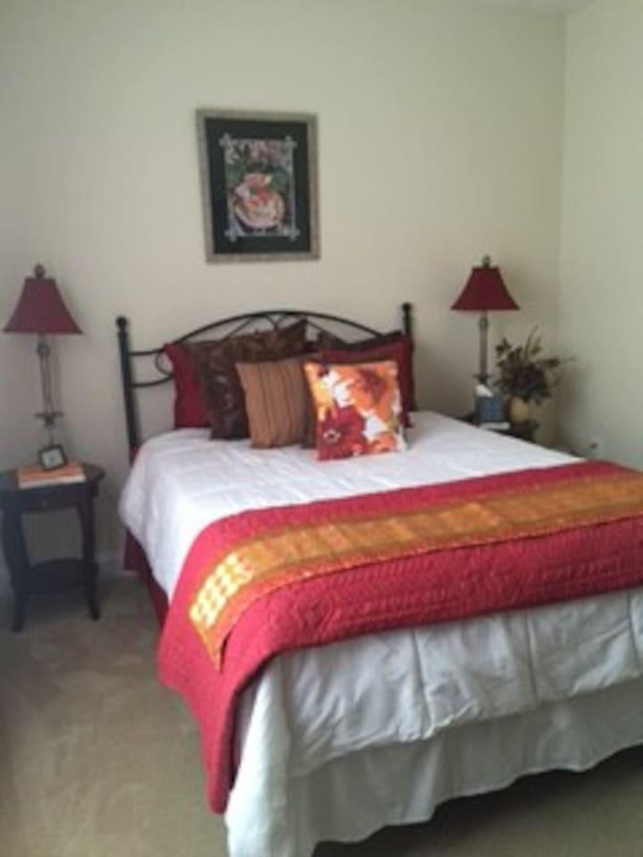 Queen bed, medium firm.