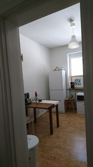 Kitchen with a table that could fold out so it become lager than in the picture.