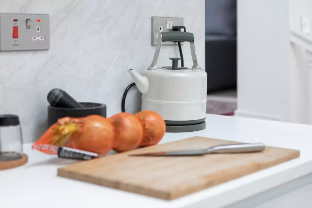 Kitchen: chopping board, and kettle