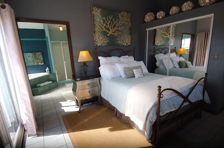 Spacious and private master bedroom located on the second floor