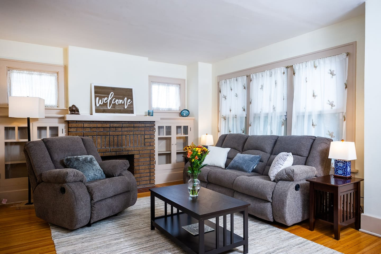 Comfy Living Room with reclining chair and couch that features two recliners. Furnished in a mission style with touch of local decor. Side tables feature handy charging stations with USB and double outlets.