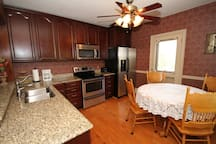 Kitchen-- full size appliances, table seats 4, counter seating for 4.