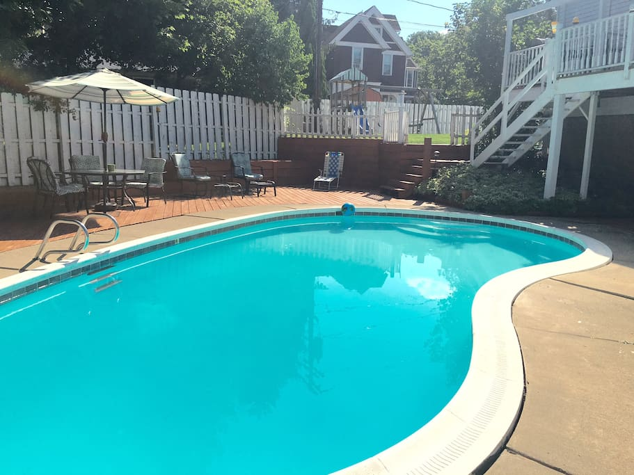 The pool is fully enclosed with privacy fencing.