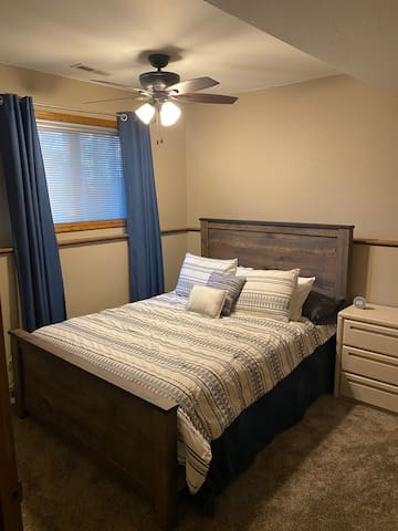 Entry level bedroom with queen bed