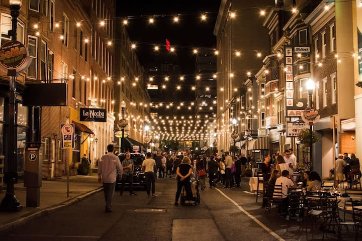 Hanging lights on 3rd St. are lit at night to create a festive ambience in the neighborhood.