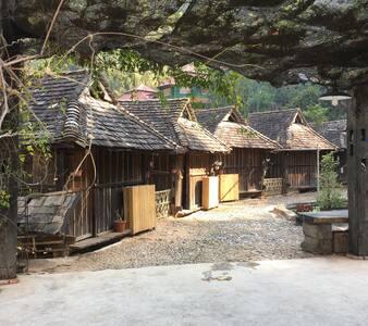 南糯山哈尼风情小木屋        福兴吉普洱茶山庄 - Xishuangbanna - Blockhütte